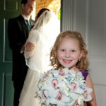 Picture of Flower girl, Bride and Groom at the door Picture