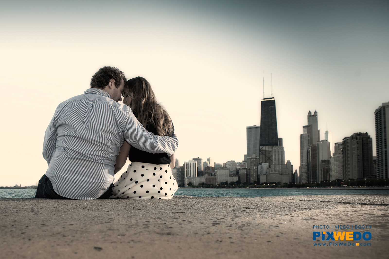 Fullerton Beach engagement photosession with chicago skyline