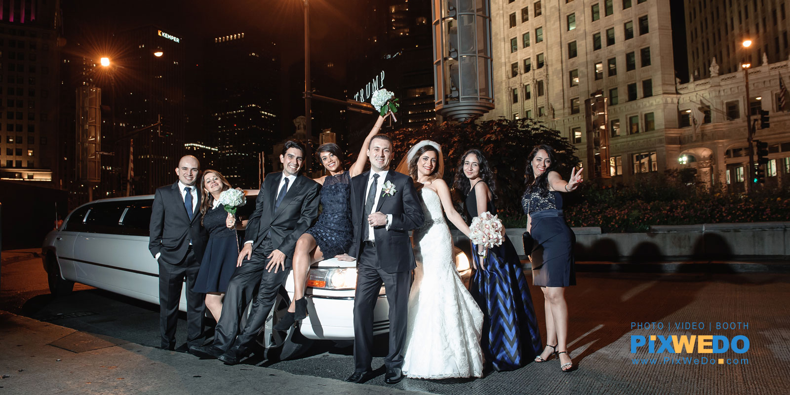 Night picture of Bridal party Michigan Avenue near Wrigley building Tramp tower